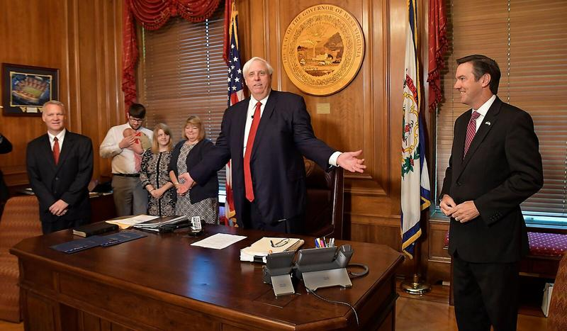 In this Aug. 25, 2018 file photo, Gov. Jim Justice announces the appointment of Congressman Evan Jenkins and former House Speaker Tim Armstead to fill vacancies on the West Virginia Supreme Court of Appeals.