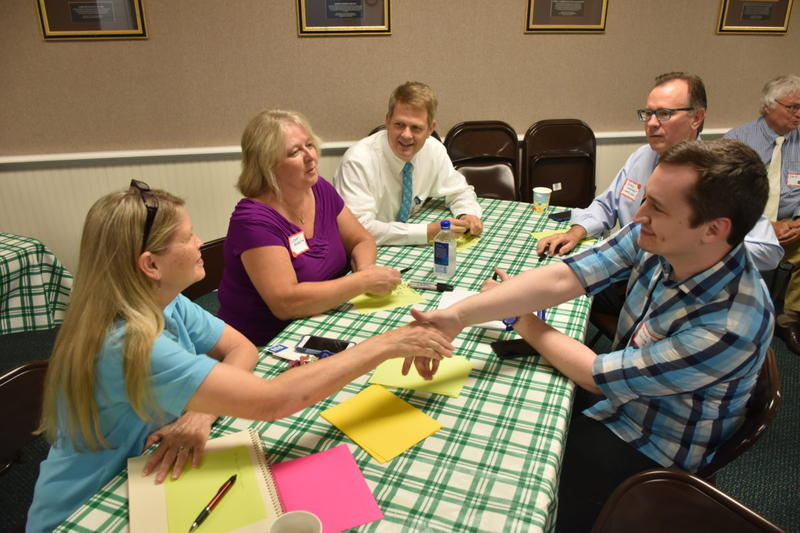 ReSource reporter Aaron Payne (right) and other journalists meet with community members in Belpre, OH.