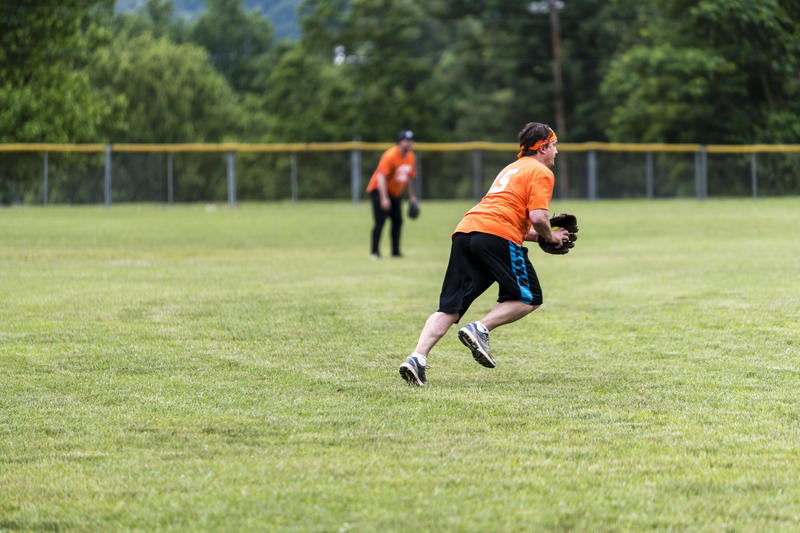 Chico's rookie Mark Downs dashes through the outfield to make a play on a base hit from Davis Cabinetry. Downs is a former FBI contractor. Such ties to law enforcement aren't enough to help the Chico's.
