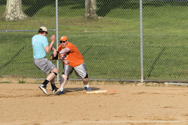 Chico's first baseman Aaron Hawley tags out a Gene's baserunner who clearly fears injury after leaving the safety of the base for a split second too long.