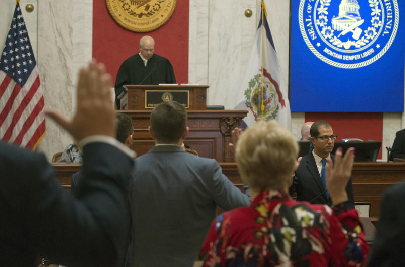 Judge Paul Farrell, presides over the Senate as senators are sworn in during a pre-trial impeachment conference for four impeached Supreme Court justices in the West Virginia State Senate chambers at the Capitol in Charleston, Sept. 11, 2018