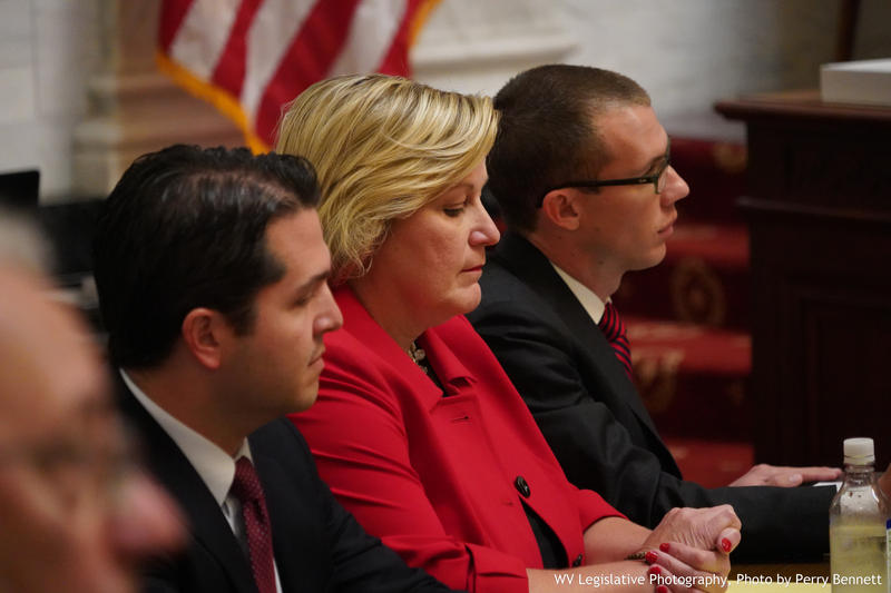 Justice Beth Walker (middle) sits with her defense attorneys Zak Richie (left) and Mike Hissam (right) on Monday, Oct. 1, 2018 on the first day of her impeachment trial.