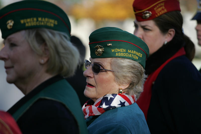 Female veterans in New York watch the grave-side ceremony for the formerly oldest living female Marine, Miriam Cohen.