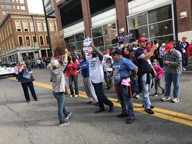 Protester and counter-protesters confront each other in the thiddle of downtown Wheeling ahead of doors opening for the rally.