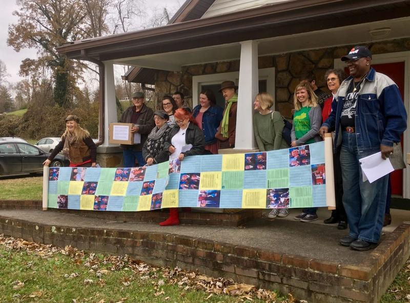 Black lung advocates hold a 'quilt' honoring those with the disease.