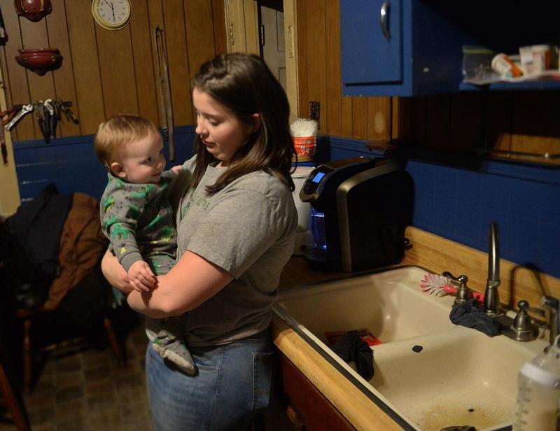 Cierra Coleman holds her 9-month-old son, Keaton, in her mother's Gary home. The Colemans bathe Keaton in bottled water.