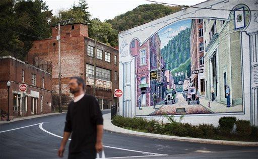 A mural depicting a more vibrant time in the town's history decorates a building in the business district, Tuesday, Oct. 6, 2015, in Welch, W.Va.