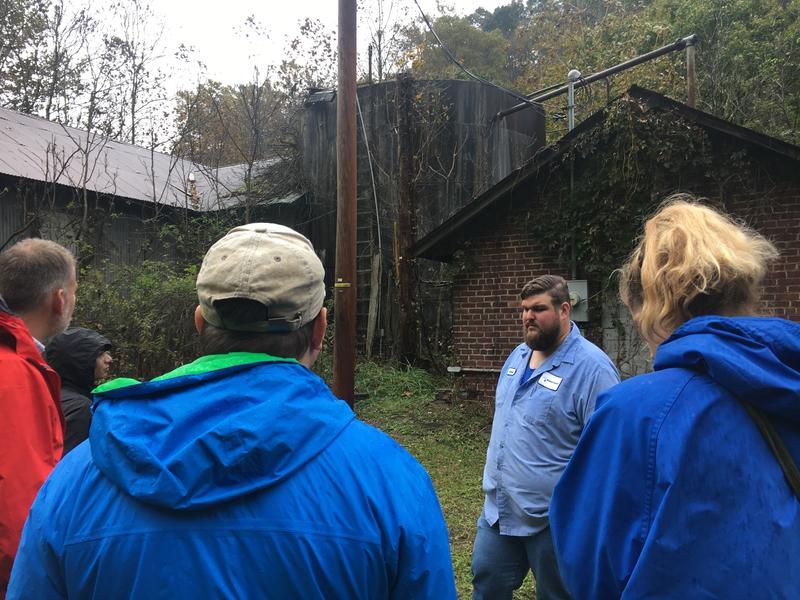 University of Pennsylvania students listen to Jared Brewster to learn more about the water systems in rural southern West Virginia.