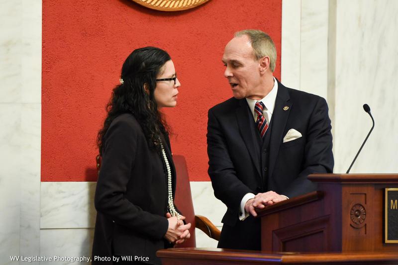 Senate Education Chair Patricia Rucker and Senate President Mitch Carmichael meet at the podium on Tuesday, Jan. 29, 2019.