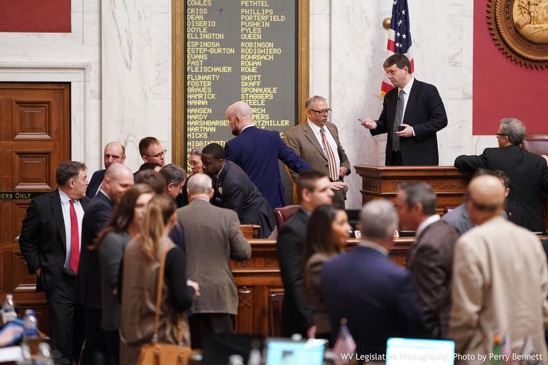 Delegates mill about the chamber during a break from debating a long, sweeping and controversial education reform bill on Wednesday, Feb. 13, 2019.