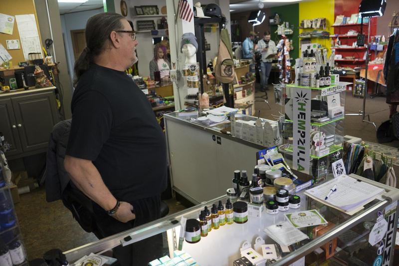 Doug Flight watches a camera crew shoot his first hemp product ad.
