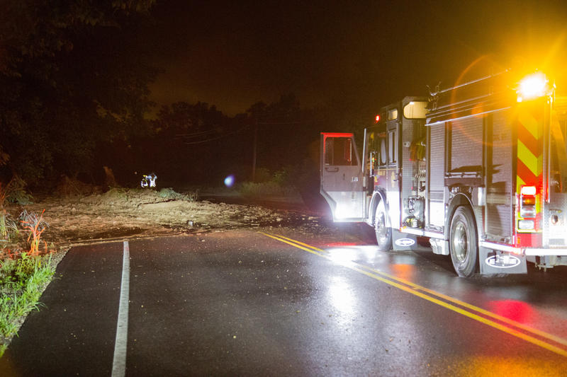 A firetruck outside Smithers, WV, warns travelers of a mudslide that obscured half the road.