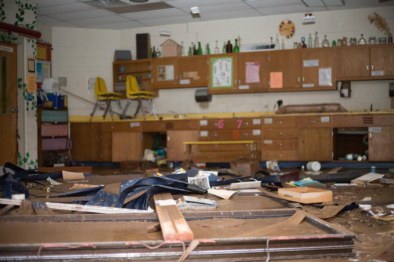 Debris covers the floor of the Richwood Middle School art room. Floodwaters completely blew out the large glass window exposing the classroom to the outdoors.