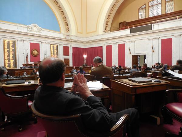 Delegate Joe Ellington listens to a presentation of the draft medical marijuana bill in the House Chambers.