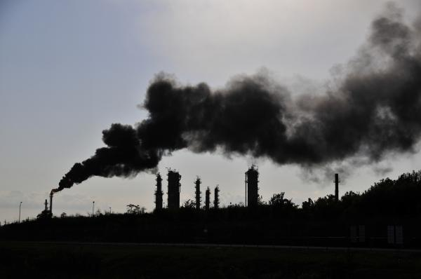 Scientists have learned flaring of excess gases at petrochemical plants and refineries, like this event in Houston, can be key contributors to ozone pollution.