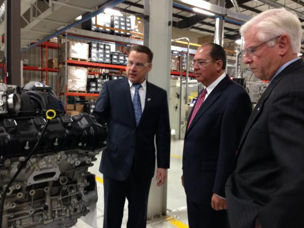 Sogefi General Manager Troy Thomas show Governor Tomblin and Department of Commerce Secretary Keith Burdette engine parts manufactured at the Wayne County plant.