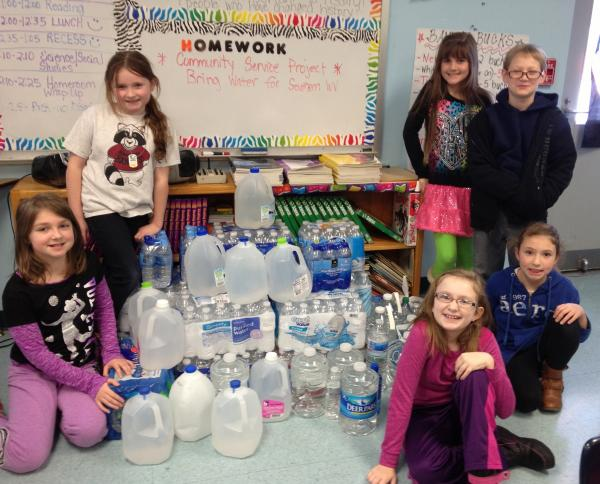 Mackenzie Fluharty (right in blue shirt) along with her class was excited to help with the water drive.