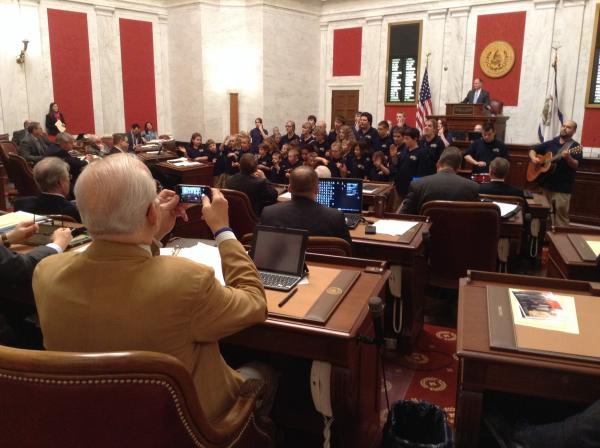 "Members of the state Senate listen as students from the W.Va. Schools for the Deaf and Blind perform ""Green Rolling Hills"" before a floor session."