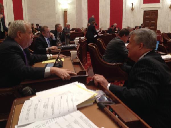 Senators Bob Williams and Bill Cole on the Senate floor.