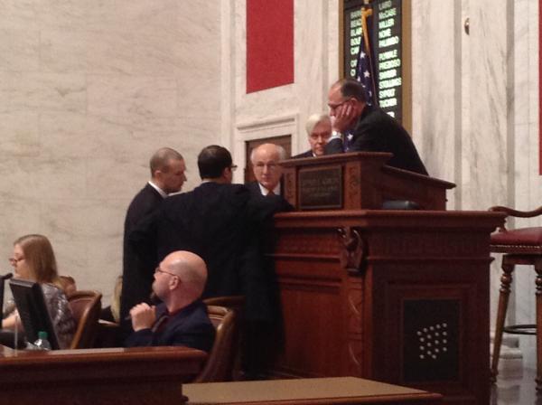 Senate President Jeff Kessler meets with leadership during a floor session.