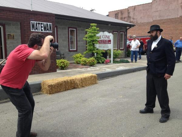 Roger May photographs Eric Simon of Williamson, West Virginia. Simon played the role of Matewan Chief of Police Sid Hatfield in a reenactment of the Matewan Massacre on May 18, 2013.