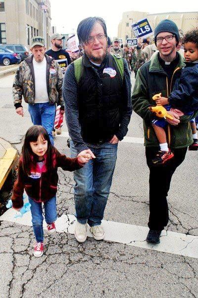 Michael Iafrate, center, walks with his daughter Hazel during a coal miner rally in Charleston, W. Va. Iafrate is a doctoral student of theology from Wheeling. He is a board member of the Catholic Committee of Appalachia and the chair of the pastoral committee. Iafrate will also be the lead author of the third pastoral letter, which will likely be published in 2015. (Photo courtesy Michael Iafrate)