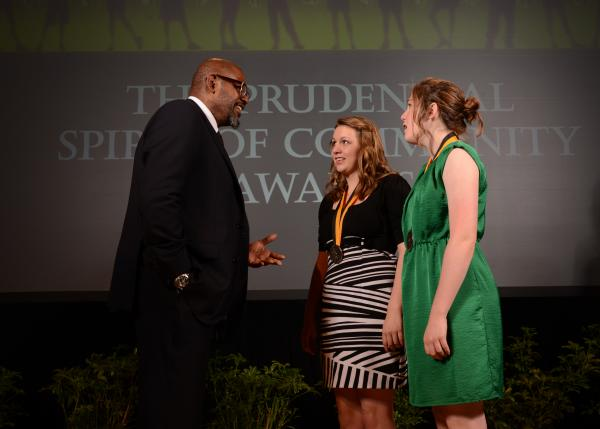 Academy Award-winning actor Forest Whitaker congratulates Katie Cowie, 17, of Milton (center) and Olivia Smith, 14, of Belleville (right) on being named West Virginia's top two youth volunteers for 2014 by The Prudential Spirit of Community Awards.