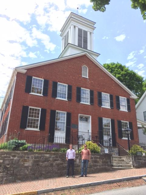 Dan Conant and Than Hitt stand in front of the Shepherdstown Presbyterian Church, which is slated to get solar panels later this summer.