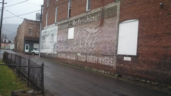 """The advertisement was considered a """"ghost mural"""" because it was faded and chipping."""