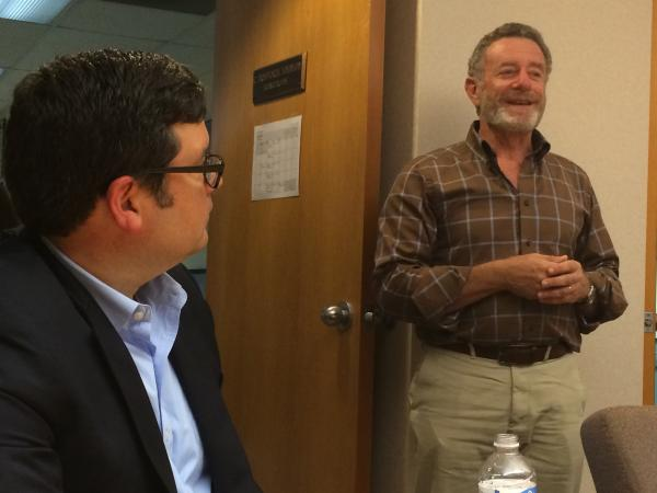 West Virginia Public Broadcasting executive director Scott Finn (left) looks on as NPR President and CEO Jarl Mohn speaks to employees, board members, and others.