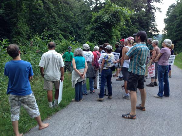 Participants in the hike stop to count a number of plants species in the Kanawha State Forest.
