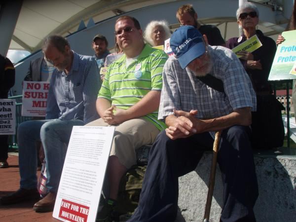 Roland Micklem (bottom right) was joined by environmental supporters at Haddad Park in Charleston on Wednesday, July 16th. On the far left is Mike Roselle, who is also fasting with Micklem.