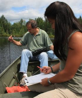 U.Va. environmental scientist Michael Pace and former U.Va. student Carol Yang conduct a water study.