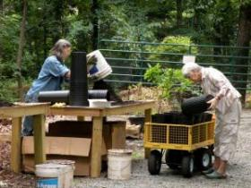 Robin Hanes and Marjie Giuliano potting trees.