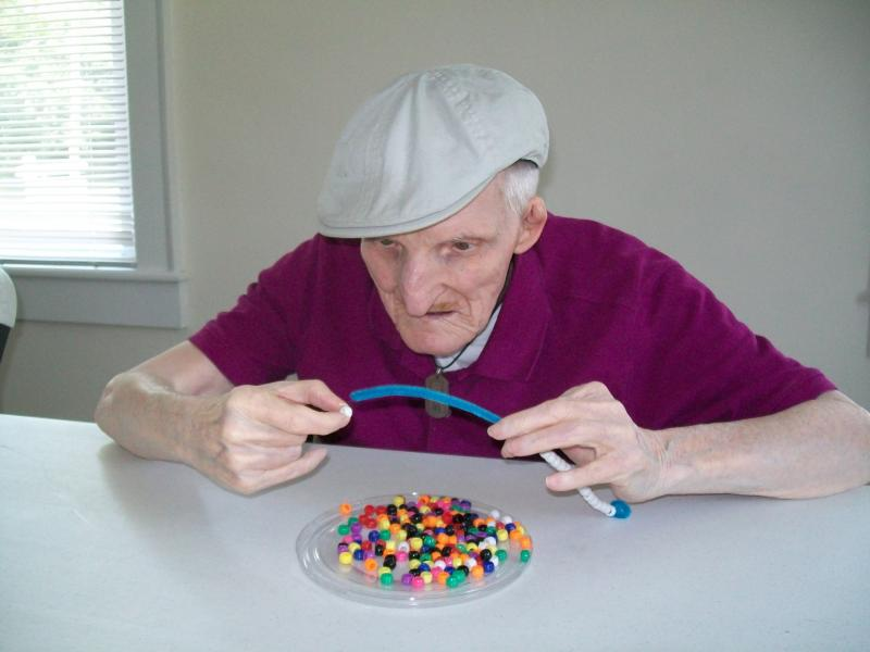Arthur works on a beading project