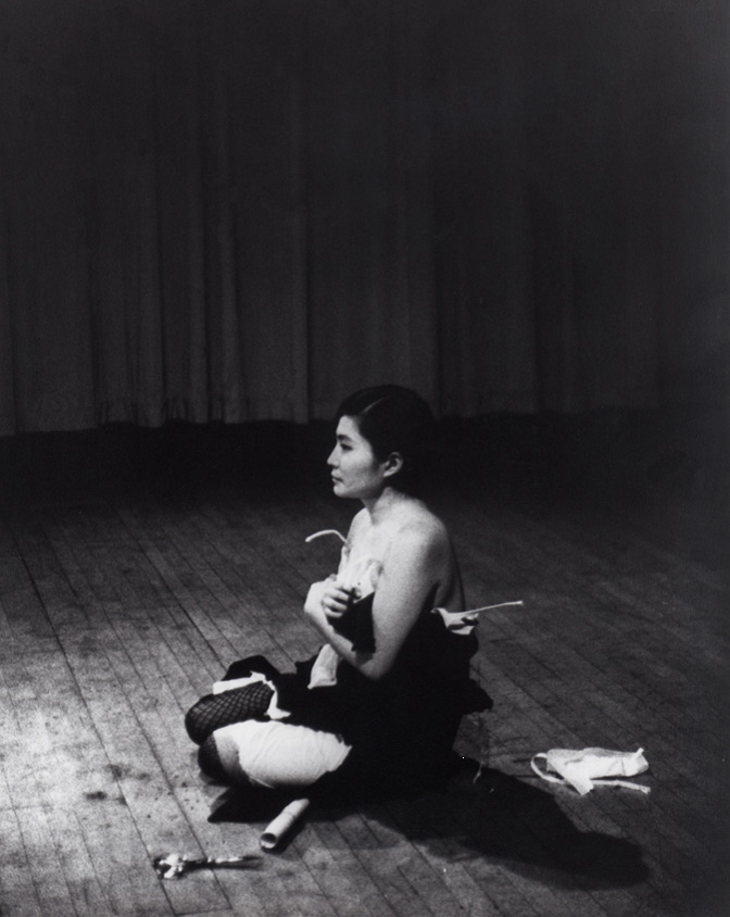 Yoko Ono - Cut Piece 1964 Performed by the artist on March 21, 1965 Carnegie Recital Hall, New York, NY Photo by Minoru Niizuma, Courtesy of Yoko Ono  Yoko Ono - Cut Piece 1964 Performed by the artist on Sept