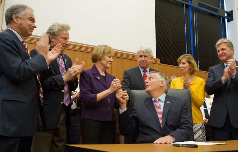 Gov. McAuliffe gives the pen he used to sign his executive order to the mother of Alison Parker.