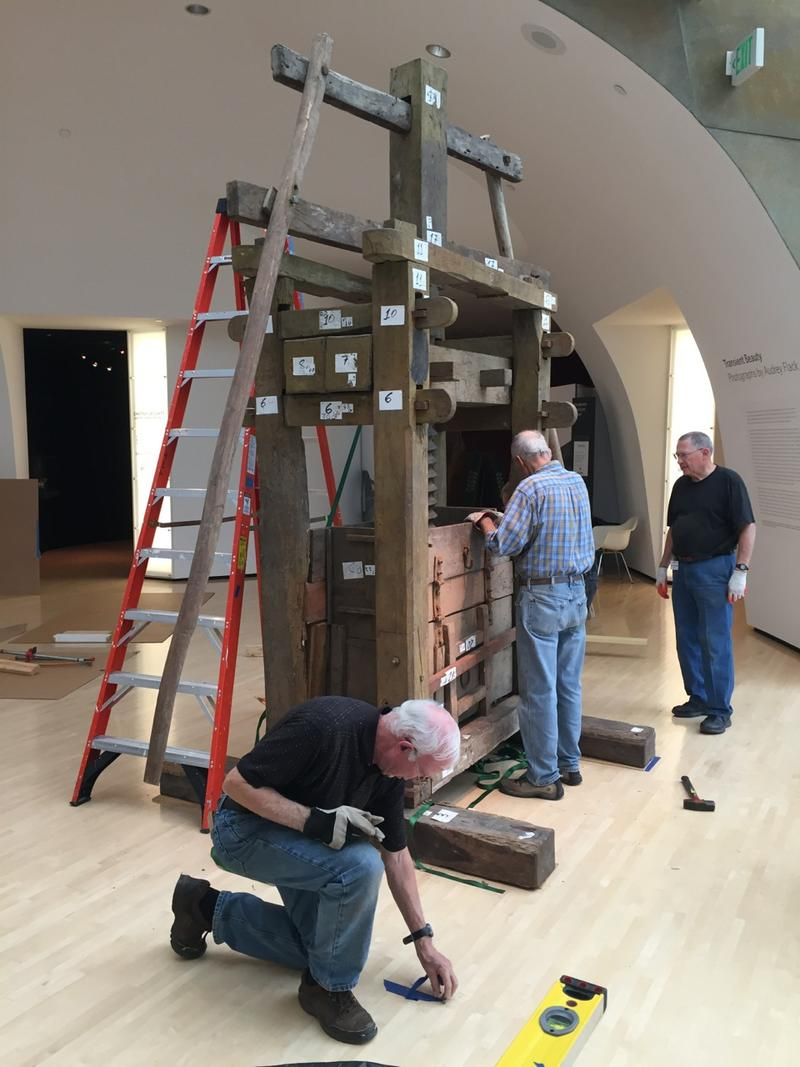 300-year-old tobacco press from Brazil is installed at the Taubman Museum of Art.