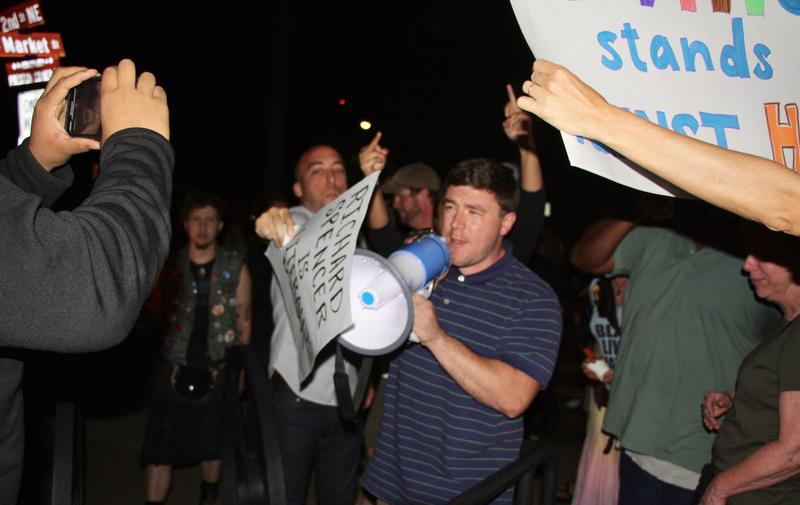 Protester Chris O'Shea attempts to muffle the mega phone of Jason Kessler, a local supporter of keeping the Lee statue in place. Kessler was arrested for disorderly conduct later in the evening.