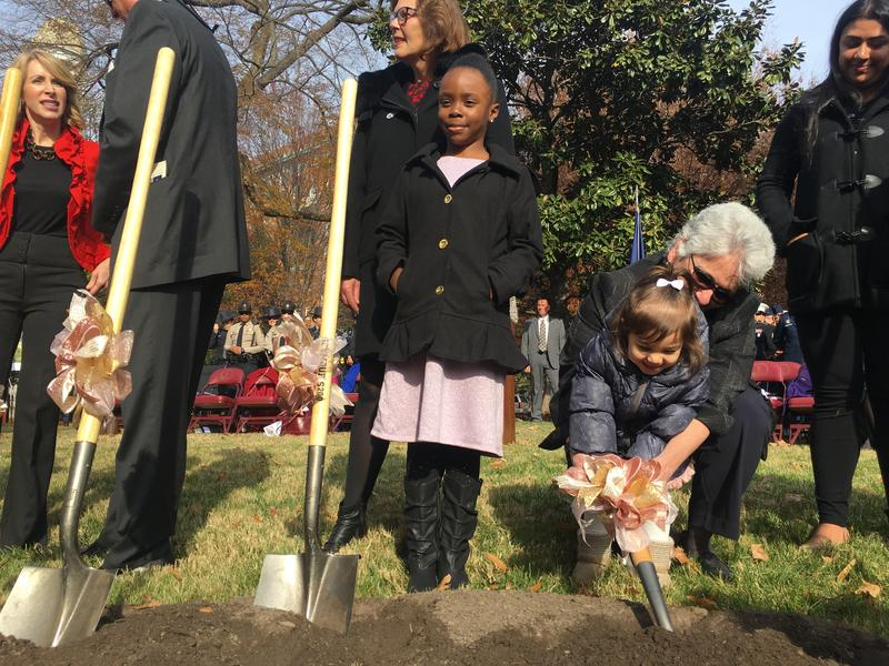 Zaria Milligan (center) was one of several young women at the ceremony. Virginia Secretary of Administration Nancy Rodriguez (right) brought her 2-year-old granddaughter as a special guest.