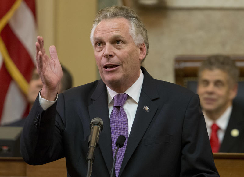 Virginia Gov. Terry McAuliffe gestures as he addresses a joint session of the the 2018 session in the House chambers at the Capitol in Richmond, Va., Wednesday, Jan. 10, 2018.