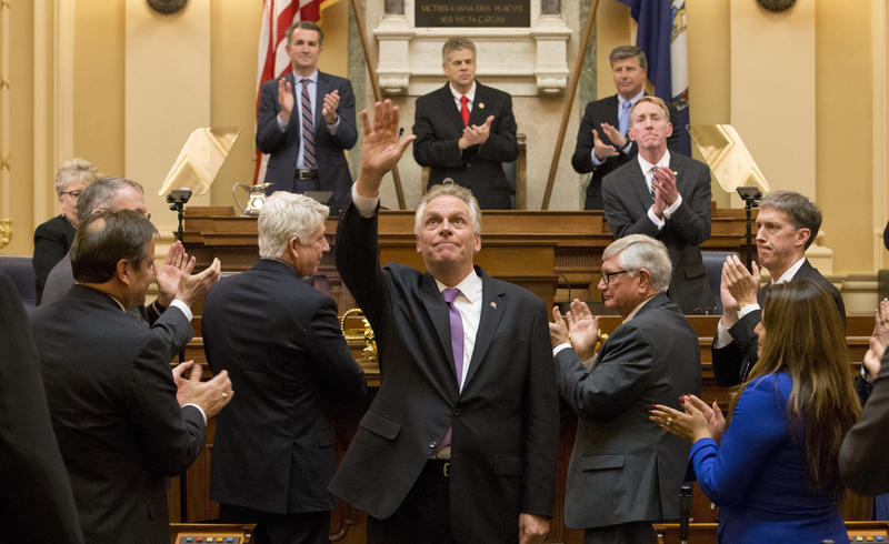 "Virginia Gov. Terry McAuliffe, center, waves to the crowd after addressing a joint session of the the 2018 Virginia General Assembly for his last ""State of the Commonwealth"" in the House chambers at the Capitol in Richmond, Va., Wednesday, Jan. 10, 2018."