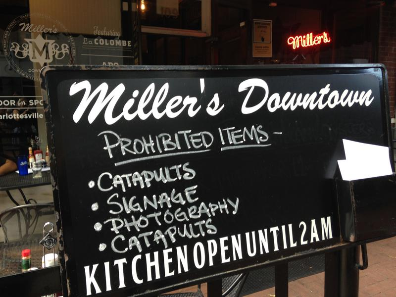 A sign outside Miller's pub mocks city rules banning everyday items like skateboards, bottles and cans because they could be used as weapons.