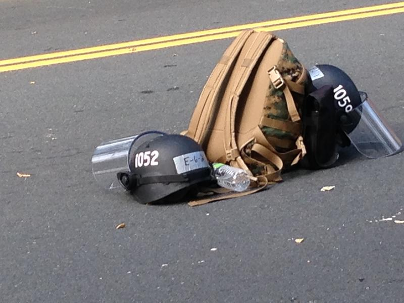 In the heat, some state policemen dropped their gear in the middle of Market Street.