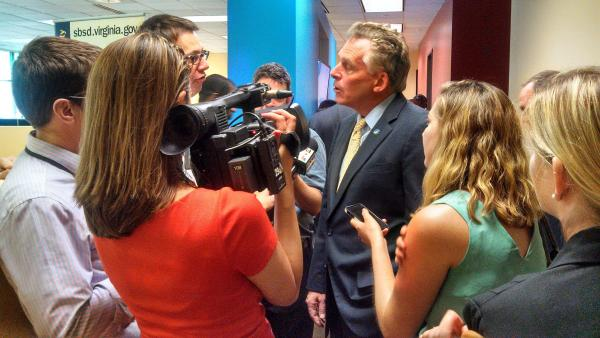 Reporters interview Gov. McAuliffe after a news conference today.