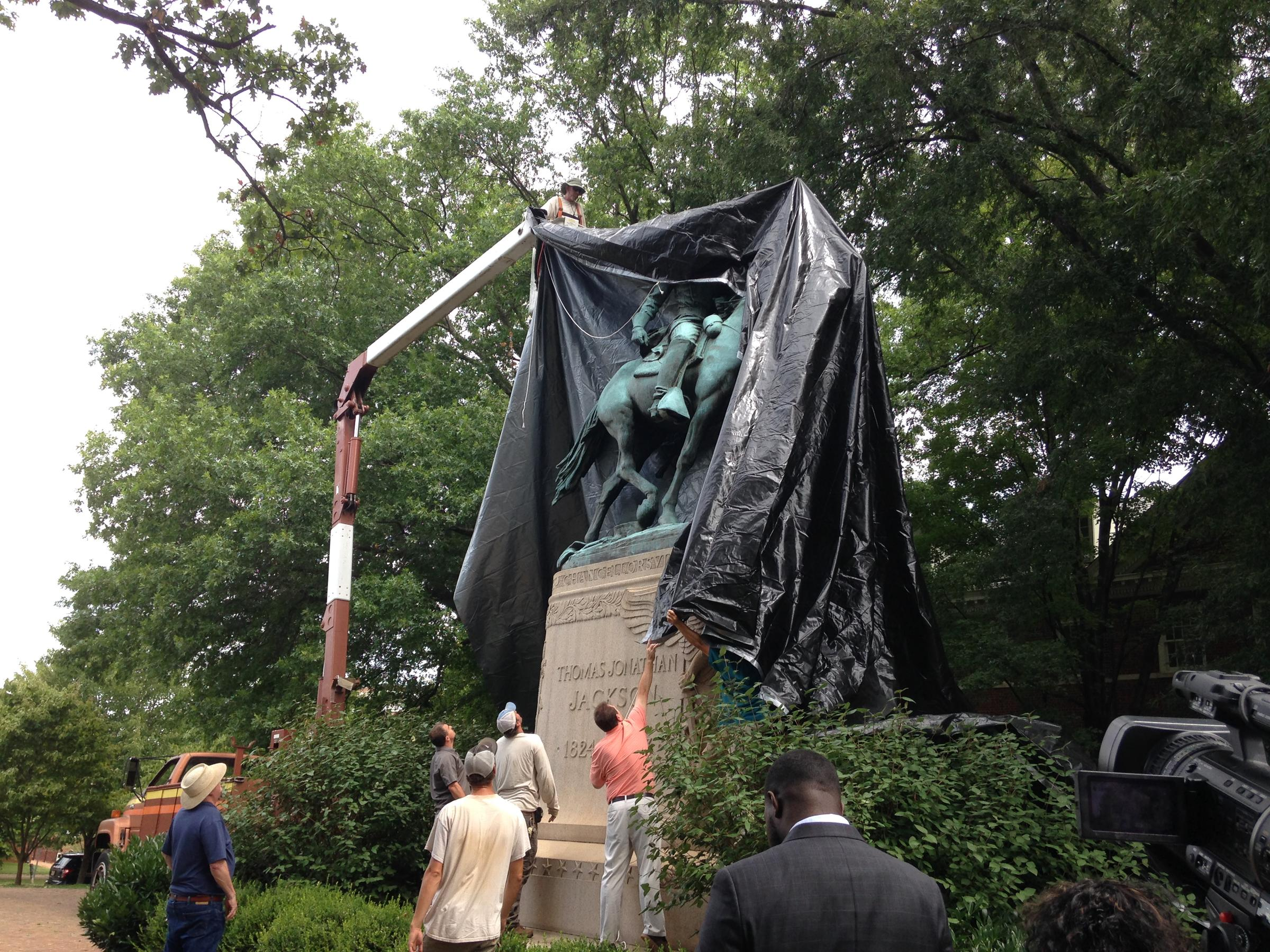 Judge calls for removal of tarps from Charlottesville's Confederate statues