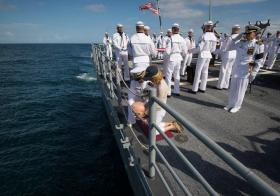 US Navy Lieutenant Commander Paul Nagy, USS Philippine Sea, and Carol Armstrong, wife of Neil Armstrong, commit the cremains of Neil Armstrong to sea during a burial at sea service held onboard the USS Philippine Sea (CG 58), Friday, Sept. 14, 2012, in the Atlantic Ocean.