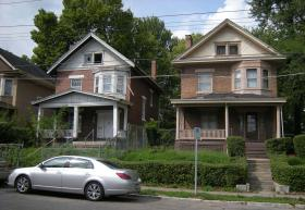 These foreclosed homes in Evanston are decreasing area property values. Evanston is part of a pilot program where banks are held responsible for cutting the grass and taking care of the properties they own
