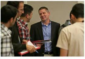 Social Entrepreneurship Center Director Brett Smith (center) of Miami University's Farmer School of Business.