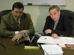 From left: Board of Elections member Alex Triantafilou and chair Tim Burke after a February hearing on voter fraud.